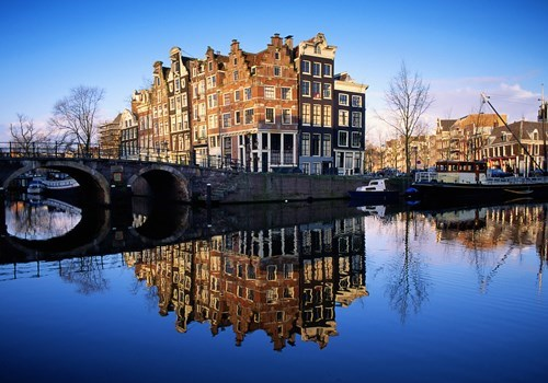 Houses reflected in canal in Amsterdam, the Netherlands/Holland
