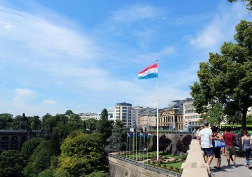 Luxembourgian flag flying over the city